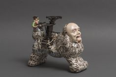 Richard Stratton, Banker's Dog, 2013. This Portage Award winning agate ware creation has a body press moulded from a poodle plastic watering can. Most unusual for agate ware to be used in the creation of a poodle.