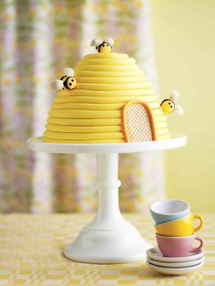 "Now that's one beehive I wouldn't mind breaking into. Learn how to make it in Pamela Clark's ""Big Book of Kids' Birthday Cakes.""  http://www.barnesandnoble.com/w/big-book-of-kids-birthday-cakes-pamela-clark/1116817729?ean=9781454911876"