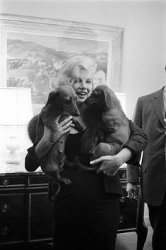 Marilyn Monroe, juggling dachshunds.