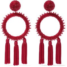 """""""Tassel earrings are the perfect finishing touch,"""" believes Oscar de la Renta. This oversized pair is embellished with light-catching red beads and strung wi…"""