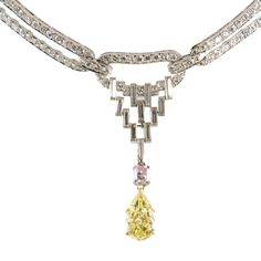 Highly Prized Art Deco Fancy Colored Diamond Necklace | From a unique collection of vintage drop necklaces at http://www.1stdibs.com/jewelry/necklaces/drop-necklaces/