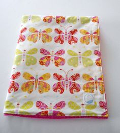 Latest single fabric minky baby blanket listed in my shop. Sewn from Dena Designs for Free Spirit's Kumari Garden Sacha print which is packed with colorful butterflies. Backed with Shannon Fabrics' fuchsia cuddle dot minky and interlined with a layer of Warm & Natural cotton batting. Think Spring!