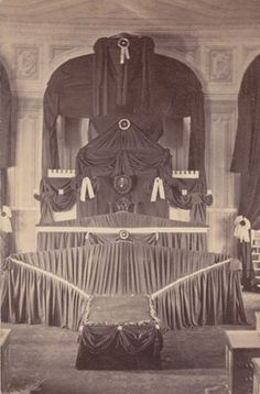 Abraham Lincoln's catafalque, a temporary structure built to support his coffin during the three days he lay in state in the U. S. Capitol Rotunda in April 1865. Although the original photographer is unknown, we do know that D.C. Burnite of Harrisburg, Pennsylvania, created this small size photographic print called a carte-de-visite. Many people collected mementos like this to help them visualize the events of President Lincoln's funeral and as a way of expressing the national grief.