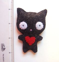 Cat Felt Pin - https://www.etsy.com/listing/120805597/black-cat-felt-brooch-felt-pin-cute?ref=unav_listing-other    (02.21.15)