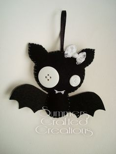 Bat felt plushies. Hand sewn with ribbon hanging loops, button eyes, lace bows and stiffened felt hats