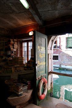 Imagine floating by on a gondola to see a wealth of books behind a door opening straight onto the canal...
