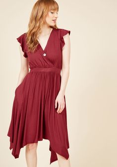 <p>Maybe it's the radiantly ruffled shoulders and buoyant handkerchief hem, or maybe it's the lighthearted attitude they inspire in you - either way, when you rock this jersey knit frock, it's evident that a vacay state of mind has taken hold! A wondrous burgundy hue colors the surplice neckline, elasticized waist, and floaty skirt of this ModCloth namesake label piece, enlivening the delightful daydreamer within!</p>