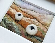 Sheep on a rolling hillside - miniature fiber art in felting and embroidery