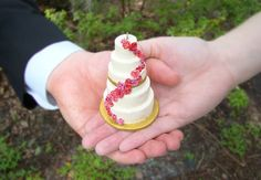 Have an exact mini replica of your wedding cake made into an ornament for first christmas together!