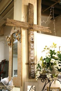 """A barnwood cross  that features """"With the Help of God """" written in French.  Love this and think I'll be making one for the Gingerbread house."""