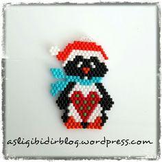 Pinguino natalizio trovate lo schema sul mio blog http://www.covodellarte.it/wpg2?g2_itemId=4783