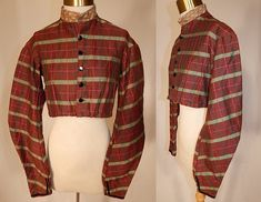 Victorian Civil War Brown Green Pink Plaid Stripe Wool Bodice Blouse Jacket Top  This antique Victorian Civil War era brown, green, pink plaid stripe wool bodice blouse jacket top dates from the 1860s. It is made of a brown fine woven wool fabric with a green and pink plaid striped pattern and black velvet ribbon trim edging the sleeves.