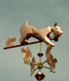 Dog weathervanes, Schnauzer Dog playing with Squirrels on weathervane directionals, photo