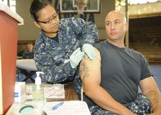 Joint Base Pearl Harbor-Hickam (JBPHH) Hospital Corpsman Abigail Doromal administers flu shot to Master Chief Gunner's Mate William Lipsett, assigned to Naval Surface Group Middle Pacific on Sept. 19. JBPHH conducted a mass vaccination exercise (SHOTEX) in conjunction with normal flu season inoculations to demonstrate the capability to rapidly and effectively vaccinate active duty military and a selected segment of the DoD population in a pandemic environment. (Photo by MCC Donald W…