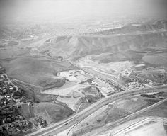 Before the 710 Freeway. If you look closely, you are able to see the Floral drive-in theater towards to the upper left of the image. The San Bernardino (10) Freeway, paralleled by Ramona Boulevard curve at forefront; City Terrace is at right background. August 25, 1958.
