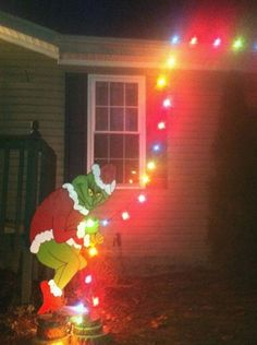 Holiday decorating just got easier! This four and half foot tall Grinch lawn ornament is perfect for outside your house. Add one strand of lights and it looks like the Grinch is at it again - stealing Christmas. Grinch Christmas Lights, Christmas String Lights, Christmas Door, Winter Christmas, Christmas Garden, Christmas Carol, Grinch Decorations, Outdoor Christmas Decorations, Christmas Themes