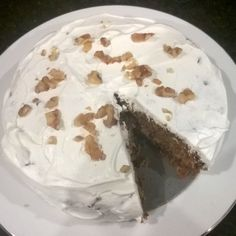 Classic Carrot cake for dessert. The combination of cinnamon, raisins and walnuts gives this classic cake a more defined texture and it tastes great too! Adjust the sweetness level of the icing to your choice.