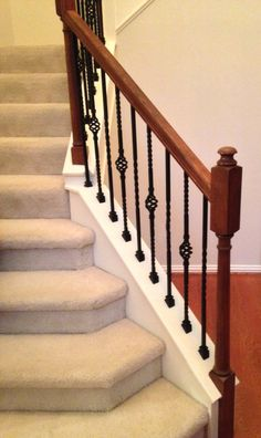 For the Watson residence, we did a full baluster swap. The old pickets were replaced with our PC4/2 and PC6/2 wrought iron balusters with a classic black finish. You can see how the iron complements the warm wood of the railing.