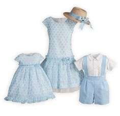 The perfect ensemble for the season. Girls dresses have shimmering blue dots against a white organza background. Ruffles and rosette accent waistline