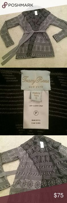 Genuine Tracy Reese Alpaca open front long sweater This is a beautiful designer sweater. Open front with belt to tie shut. 50% Alpaca and 50% acrylic. Heavy and warm! Gray and black design, great with jeans or leggings. In PERFECT condition! Dry clean only. Smoke free pet free home! Tracy Reese Sweaters