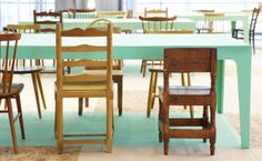 Modern table with rustic mismatched wooden chairs.
