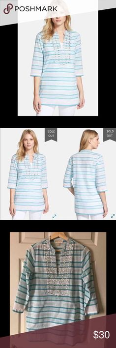 {Michael Kors} Deep Sea Stripe Studded Tunic Michael Kors Deep Sea Stripe Studded Tunic  • Size XS • A bib defined by a pattern of silver tone studs makes a gleaming focal point for an easygoing tunic cut from lightweight cotton voile with variegated stripes in a choice of summery blues  • Split side hems  • 100% Cotton  • Good condition (no stains or major defects)  • Reasonable offers welcome  • Bundle for a discount Michael Kors Tops Tunics