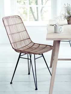 Inspired by classic 1950's design and material, our stylish dining chair has a strong black iron frame and woven rattan in tonal shades of blonde. Our contemporary twist on this classic design has been especially designed for your comfort with a wide shaped seat and tall back. Team with our Rattan Armed Chair and Rattan High Stoolfor the complete look, and use with our Raw Oak Table for casual family dining.