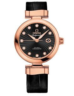 OMEGA DE VILLE LADYMATIC WATCH (Women) • In red gold with a black leather strap, the demure Ladymatic carries a scratch-resistant and antireflective sapphire-crystal face. $17,300.