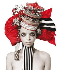she is creepy, but i love the CAROUSEL HAT...could make something similar from a paper toy carousel