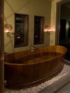A large master bathroom with a teak soaking tub