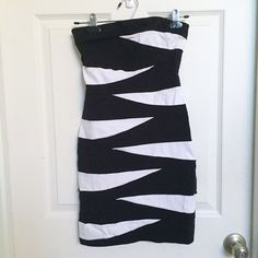 Strapless black and white dress Cute fitted dress great for any semi formal event. Worn once, no flaws. It's a little wrinkly from air drying but it can be ironed on warm (although the material is stretchy so most of the wrinkles tend to go away when you have it on). I can provide specific measurements if anyone needs them. Rayon/Nylon/Spandex. Ruby Rox Dresses Strapless