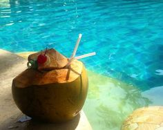 A nice refreshing coconut, sunbeds, and pool. All set for a relaxing day ahead. What more could we ask for? www.benoaresort.com #thetanjungbenoa #TheTaoBali #bali Picture by: @tainteddreamer