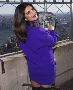 Quantico star Priyanka Chopra is on top of the world as she poses for photos at the top of the Empir... - Charles Sykes/Invision/AP