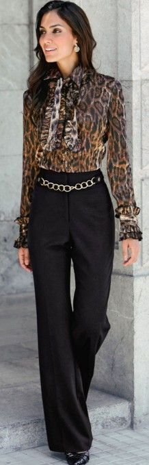 A long sleeve leopard print blouse tucked in a black dress pant with golden chain detail along with black heels - one of my favorite finds ♥
