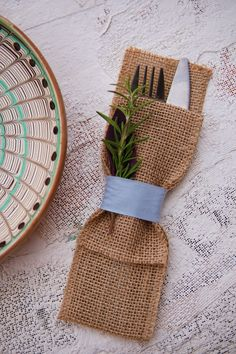 Burlap Silverware Pouches with Light Blue Ribbon - for that rustic, shabby chic table decor. By Wild Leaf Tableware
