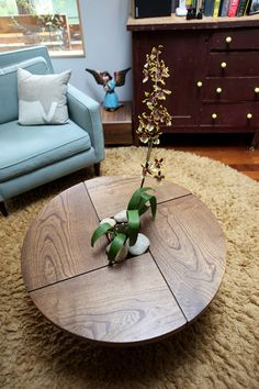I want this coffee table.. You can just detach one of the corners and put it next to a person if they're too far from the center of the sitting area... genius..