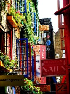 London  This is 'Neal's Yard' if anyone was wondering. Just north of Covent Garden Tube station - it's easy to miss as the entrance is narrow. It's quirky & a good spot for al-fresco coffee. Movie stars staying at the Covent Garden Hotel opposite, often mooch in here.