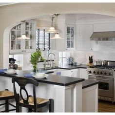 Kitchen small kitchen Design Ideas, Pictures, Remodel and Decor - I like the arch to provide some separation. Not a fan of higher bar though.