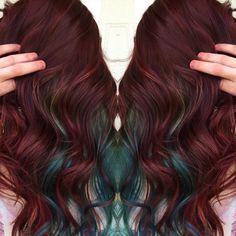 Burgundy hair color with teal peek-a-boos