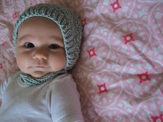 Posing sweetly for her 3 month photo shoot wearing the hat I knit her