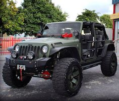 ARMY GREEN AND LIFTED MODIFIED HOOD CHANGED THE BUMPER AND RIMS THE COLOR OF THE JEEP AND HOW GREAT LOOKING THIS JEEP IS!- PERSONALIZED WELL-UNLIKE OTHERS