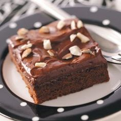 Almond Brownies Recipe -With a perfect creamy frosting and just a touch of almond flavor, these easy-to-make brownies really are something special. Keep a can of chocolate syrup on hand for this delectable treat! —Didi Desjardins, Dartmouth, Massachusetts
