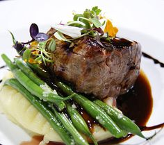 New York Strip Steak is, as you would get at any premier steakhouse. The fluffy potato puree, haricot vert and balsamic vinegar demi glaze is utter perfection paired with Malbec Argentina, 2007, Karma Meditado Gran Reserva.