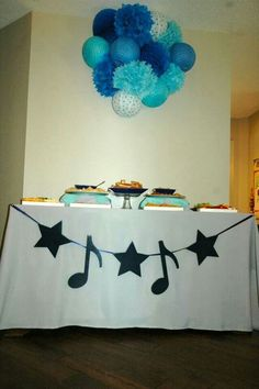 Rockstar monkey baby shower. Paper latern and tissue pom cluster.