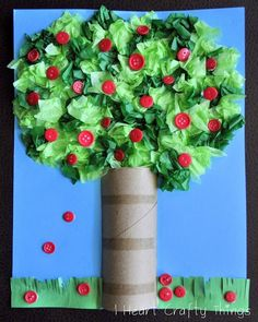 The tree is made from crumbled up green tissue paper. If you paint the toilet paper roll brown bark like I think I would look better. You can also use flower buttons to make it a cute flower blossom tree. You could even draw the fruit or flowers and cut them out.