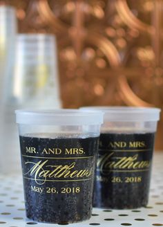 Serving signature drinks, wine, beer or soda in plastic stadium cups personalized with a wedding design or monogram, the bride and groom's name and wedding date or a personal message will add character to your wedding bar or beverage station and provide a nice wedding takeaway for guests. These clear 16 ounce stadium cups were custom printed with the couple's married name in calligraphy style under a Mr. and Mrs. design along with their wedding date in gold imprint.