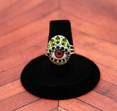 Tribal red eye ring with Swarovski in olivine green by MoonBubbles, $29.00