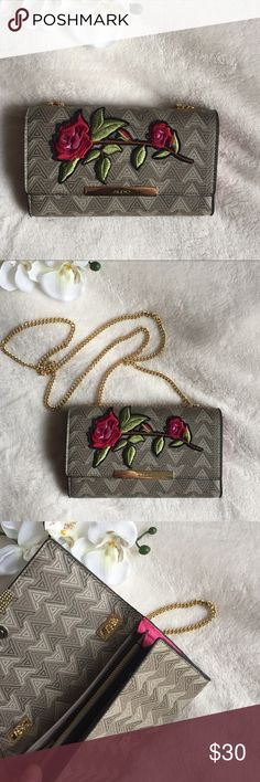 trendy clutch 💕 beautiful, brand new clutch with a rose print on the front and pretty details. never worn. Aldo Bags Clutches & Wristlets