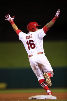 Kolten Wong celebrates his solo home run in the ninth inning to give the St. Louis Cardinals the 5 to 4 win over the San Francisco Giants during Game Two of the NLCS.  10-12-14