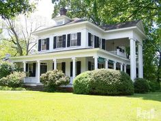 This wonderful Greek Revival beauty, known as the Allmond Holmes House, was built in 1856. Perfectly situated on a one acre lot in the historic district of downtown Clinton, North Carolina. Behind the home, and included in the sale, are 3 other structures - the interesting original smoke house and two guest houses. Some updating is required, but the numerous original architectural details are astounding.